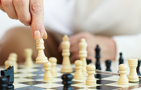 Hand moving a chess piece